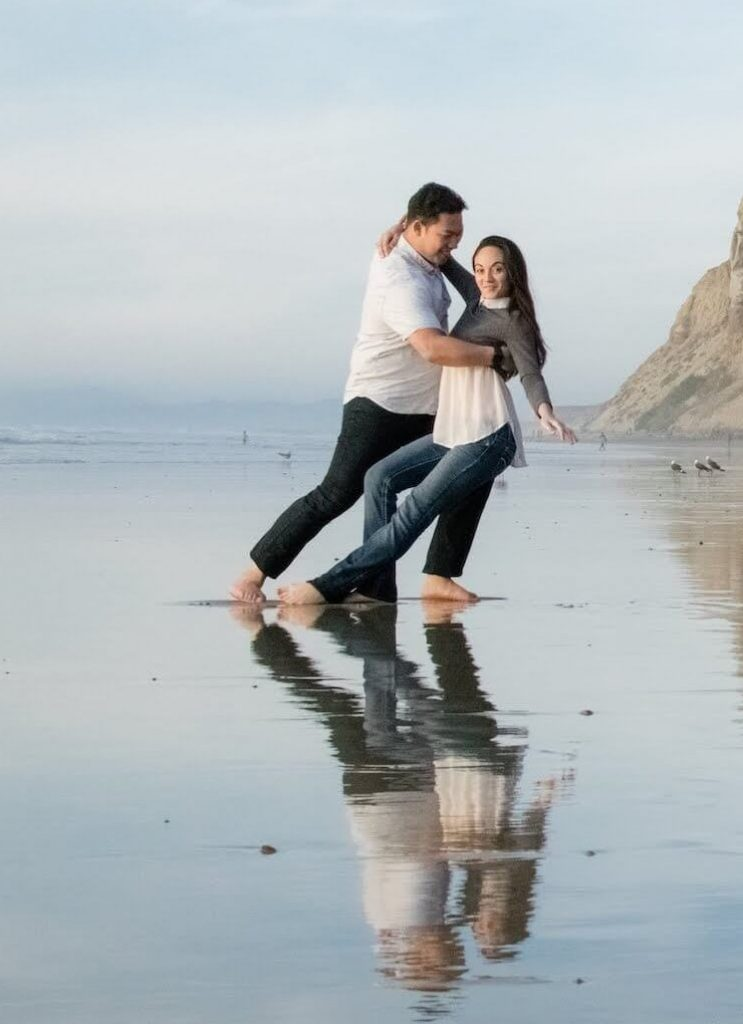 couple dancing west coast swing on beach